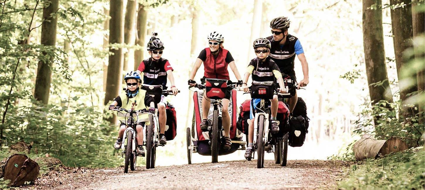 Family cycling in the woods